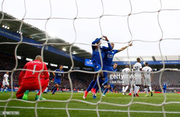 Wilfred Ndidi of Leicester City celebrates scoring his sides first goal with Yohan Benalouane of Leicester City during the Premier League match...