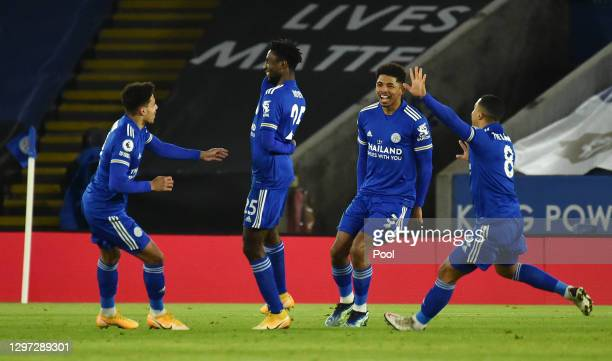 Wilfred Ndidi of Leicester City celebrates with team mates James Justin, Wesley Fofana and Youri Tielemans after scoring their side's first goal...