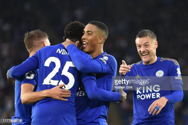 Wilfred Ndidi of Leicester City celebrates with teammates after scoring his team's fifth goal during the Premier League match between Leicester City...