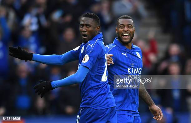 Wilfred Ndidi of Leicester City celebrates with Wes Morgan of Leicester City after Tom Huddlestone of Hull City scored a own goal for Leicester City...