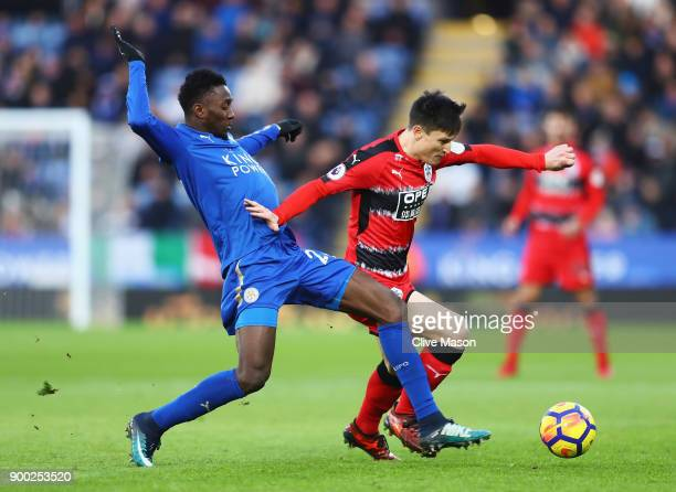 Wilfred Ndidi of Leicester City challenges Joe Lolley of Huddersfield Town during the Premier League match between Leicester City and Huddersfield...
