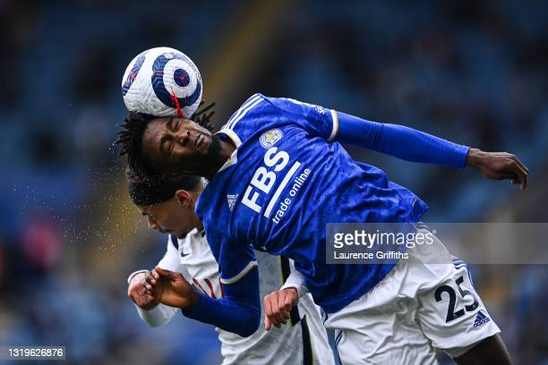 Wilfred Ndidi of Leicester City competes for a header with Dele Alli of Tottenham Hotspur during the Premier League match between Leicester City and...