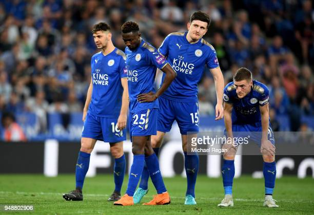 Wilfred Ndidi of Leicester City Harry Maguire of Leicester City and Jamie Vardy of Leicester City react during the Premier League match between...