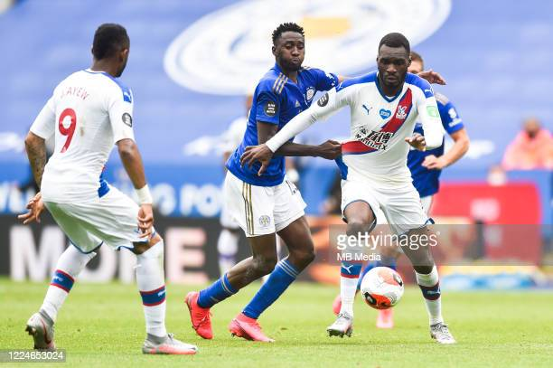 Wilfred Ndidi of Leicester City holds back Christian Benteke of Crystal Palace during the Premier League match between Leicester City and Crystal...