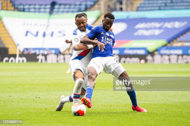 Wilfred Ndidi of Leicester City holds off Jordan Ayew of Crystal Palace during the Premier League match between Leicester City and Crystal Palace at...