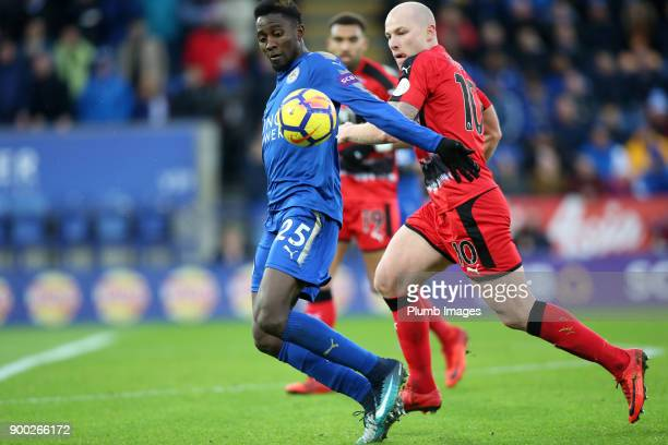 Wilfred Ndidi of Leicester City in action with Aaron Mooy of Huddersfield during the Premier League match between Leicester City and Huddersfield at...