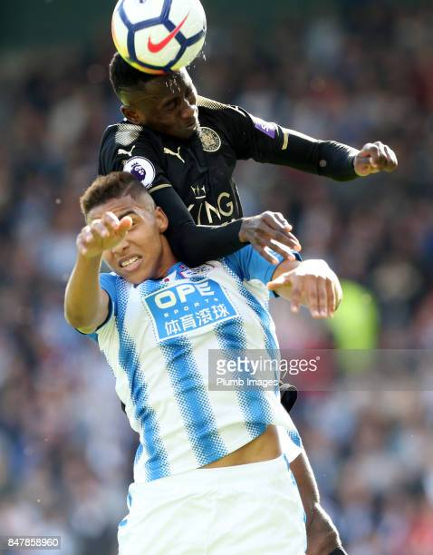 Wilfred Ndidi of Leicester City in action with Abdelhamid Sabiri of Huddersfield Town during the Premier League match between Huddersfield Town and...