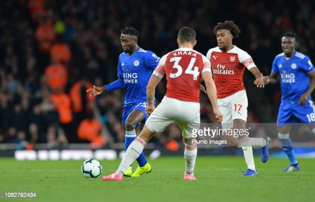 Wilfred Ndidi of Leicester City in action with Alex Iwobi and Granit Xhaka of Arsenal during the Premier League match between Arsenal FC and...
