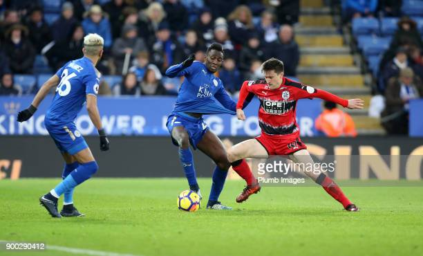 Wilfred Ndidi of Leicester City in action with Joe Lolley of Huddersfield during the Premier League match between Leicester City and Huddersfield at...