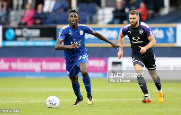 Wilfred Ndidi of Leicester City in action with Jordan Cook of Luton Town during the pre season friendly between Luton Town and Leicester City on July...