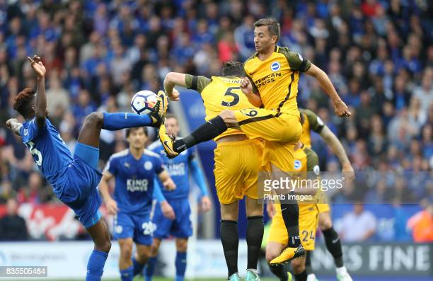 Wilfred Ndidi of Leicester City in action with Markus Suttner of Brighton and Hove Albion during the Premier League match between Leicester City and...
