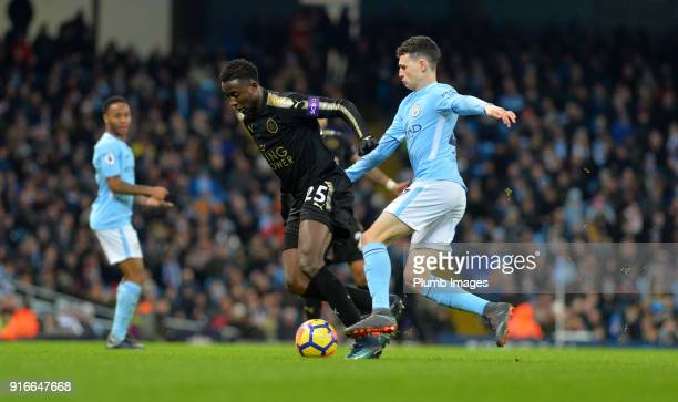 Wilfred Ndidi of Leicester City in action with Phil Foden of Manchester City during the Premier League match between Manchester City and Leicester...