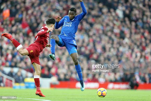 Wilfred Ndidi of Leicester City in action with Phillippe Coutinho of Liverpool during the Premier League match between Liverpool and Leicester City...