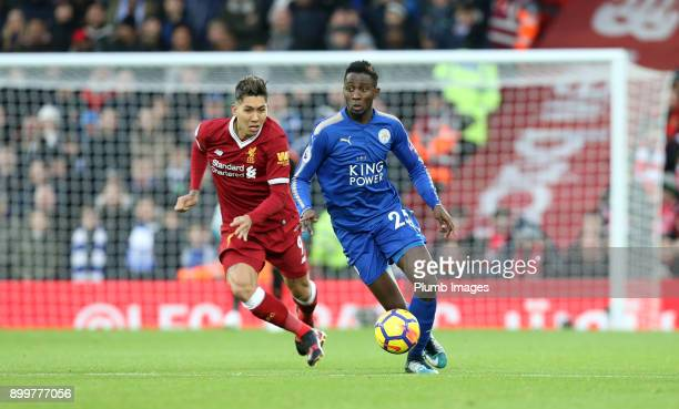 Wilfred Ndidi of Leicester City in action with Roberto Firmino of Liverpool during the Premier League match between Liverpool and Leicester City at...