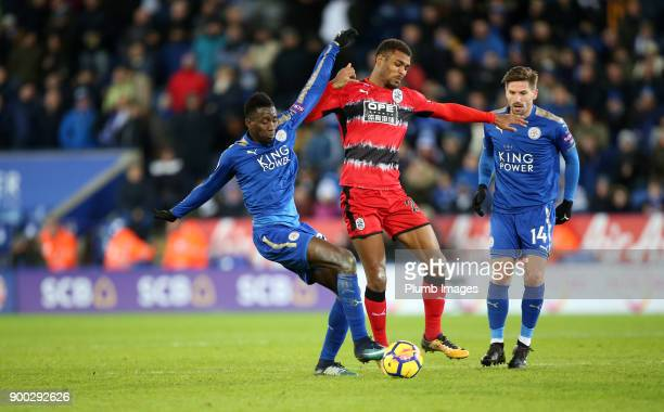 Wilfred Ndidi of Leicester City in action with Steve Mounie of Huddersfield during the Premier League match between Leicester City and Huddersfield...