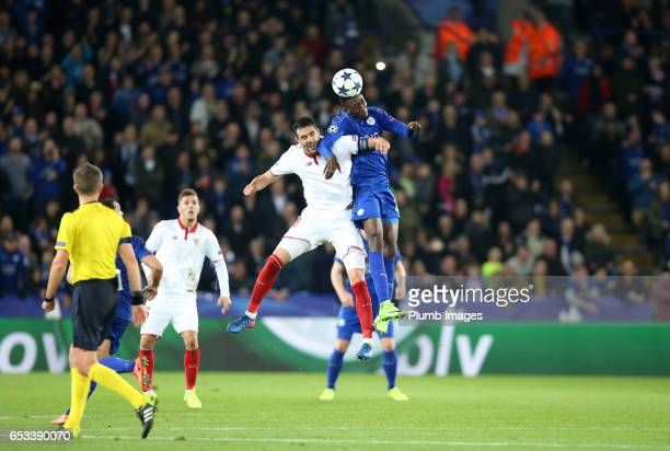 Wilfred Ndidi of Leicester City in action with Vicente Iborra of Sevilla during the UEFA Champions League Round of 16 match between Leicester City...
