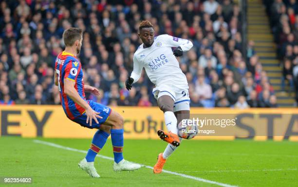 Wilfred Ndidi of Leicester City in action with Yohan Cabaye of Crystal Palace during the Premier League match between Crystal Palace and Leicester...