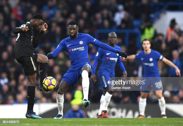 Wilfred Ndidi of Leicester City is challenged by Antonio Rudiger of Chelsea during the Premier League match between Chelsea and Leicester City at...