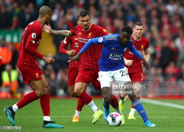 Wilfred Ndidi of Leicester City is challenged by Dejan Lovren of Liverpool during the Premier League match between Liverpool FC and Leicester City at...