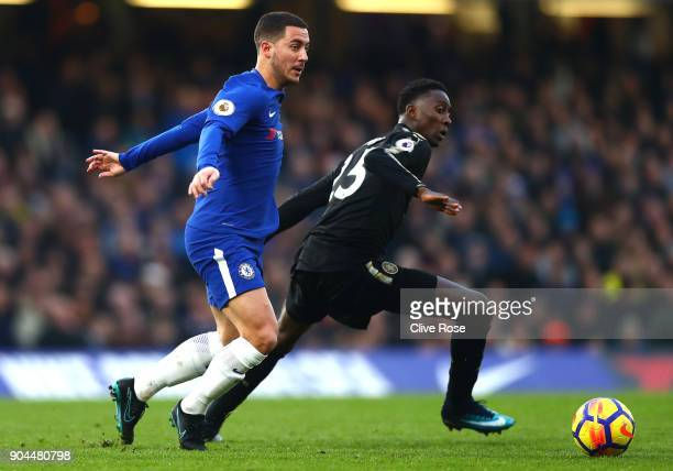 Wilfred Ndidi of Leicester City is challenged by Eden Hazard of Chelsea during the Premier League match between Chelsea and Leicester City at...