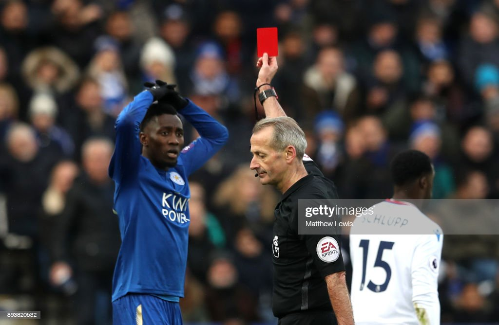 Wilfred Ndidi of Leicester City is shown a red card by referee Martin Atkinson during the Premier League match between Leicester City and Crystal Palace at The King Power Stadium on December 16, 2017 in Leicester, England.