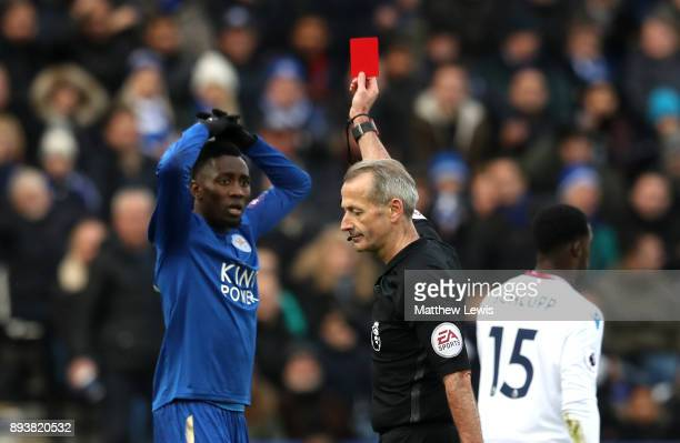 Wilfred Ndidi of Leicester City is shown a red card by referee Martin Atkinson during the Premier League match between Leicester City and Crystal...
