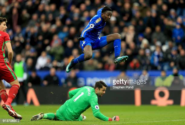Wilfred Ndidi of Leicester City jumps over Jack Butland of Lukasz Fabianski of Swansea City during the Premier League match between Leicester City...