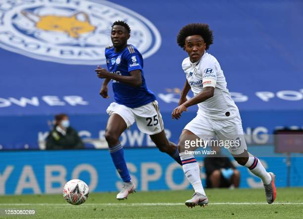 Wilfred Ndidi of Leicester City looks on as Willian of Chelsea controls the ball during the FA Cup Fifth Quarter Final match between Leicester City...