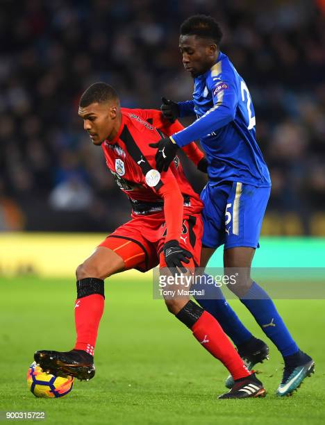 Wilfred Ndidi of Leicester City tackles Collin Quaner of Huddersfield Town during the Premier League match between Leicester City and Huddersfield...