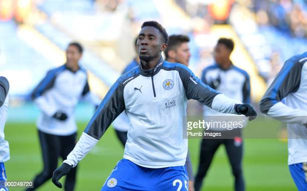 Wilfred Ndidi of Leicester City warms up at King Power Stadium ahead of the Premier League match between Leicester City and Huddersfield at King...