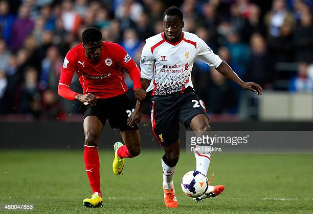 Wilfred Zaha of Cardiff battles with Aly Cissokho of Liverpool during the Barclays Premier League match between Cardiff City and Liverpool at Cardiff...