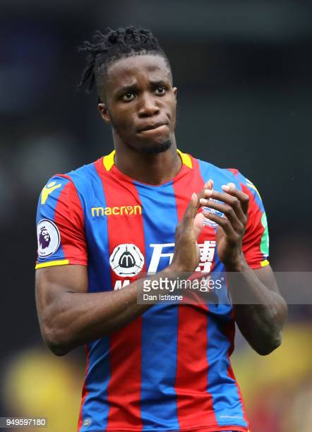 Wilfred Zaha of Crystal Palace applauds the fans following the Premier League match between Watford and Crystal Palace at Vicarage Road on April 21...