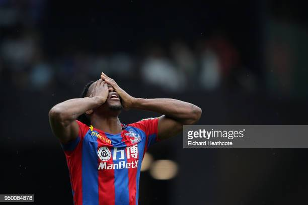 Wilfred Zaha of Palace reacts after getting a yellow card during the Premier League match between Watford and Crystal Palace at Vicarage Road on...