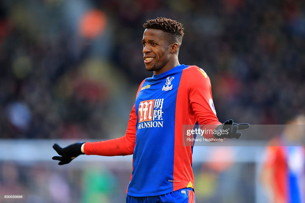 Wilfred Zaha of Palace remonstrates with a linesman during the Premier League match between Watford and Crystal Palace at Vicarage Road on December 26, 2016 in Watford, England.