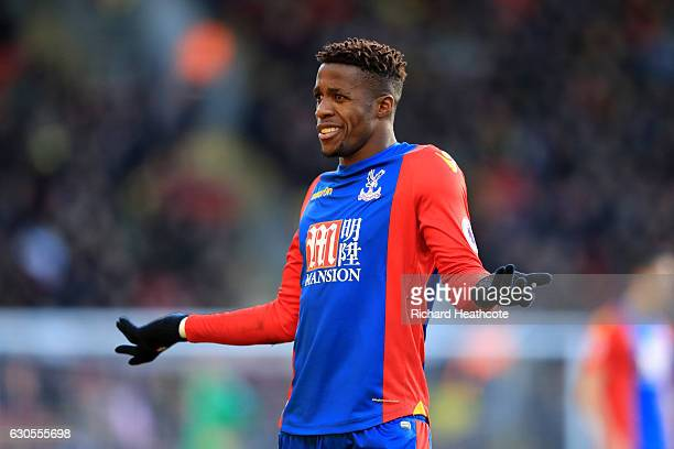 Wilfred Zaha of Palace remonstrates with a linesman during the Premier League match between Watford and Crystal Palace at Vicarage Road on December...