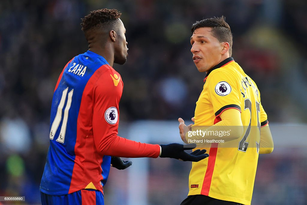 Wilfred Zaha of Palace remonstrates with Jose Holebas of Watford during the Premier League match between Watford and Crystal Palace at Vicarage Road on December 26, 2016 in Watford, England.