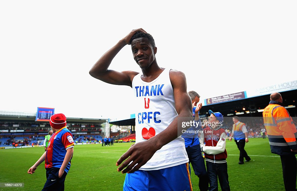 Wilfred Zaha of Palace shows off a t-shirt saying 'Thank You CPFC' during the players parade after the match during the npower Championship match between Crystal Palace and Peterborough United at Selhurst Park on May 04, 2013 in London, England.