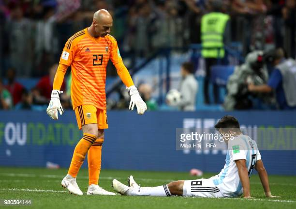 Wilfredo Caballero of Argentina and Marcos Acuna of Argentina look dejected during the 2018 FIFA World Cup Russia group D match between Argentina and...