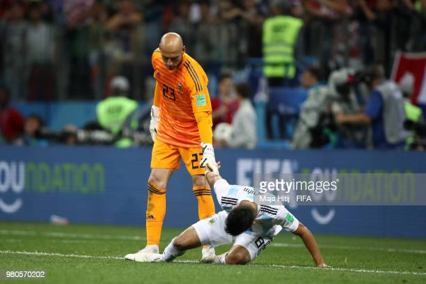 Wilfredo Caballero of Argentina consoles team mate Marcos Acuna during the 2018 FIFA World Cup Russia group D match between Argentina and Croatia at...