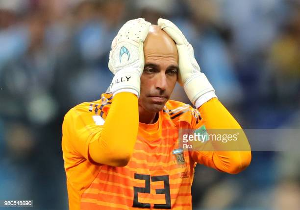 Wilfredo Caballero of Argentina holds his head in his hands as he stands dejected after his mistake leads to a Croatia goal scored by Ante Rebic...