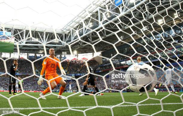 Wilfredo Caballero of Argentina looks dejected as Alfred Finnbogason of Iceland celebrates after scoring his team's first goal during the 2018 FIFA...