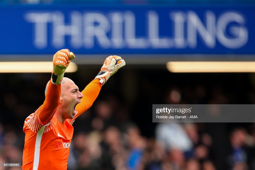Wilfredo Caballero of Chelsea celebrates the first goal during the Premier League match between Chelsea and Tottenham Hotspur at Stamford Bridge on April 1, 2018 in London, England.
