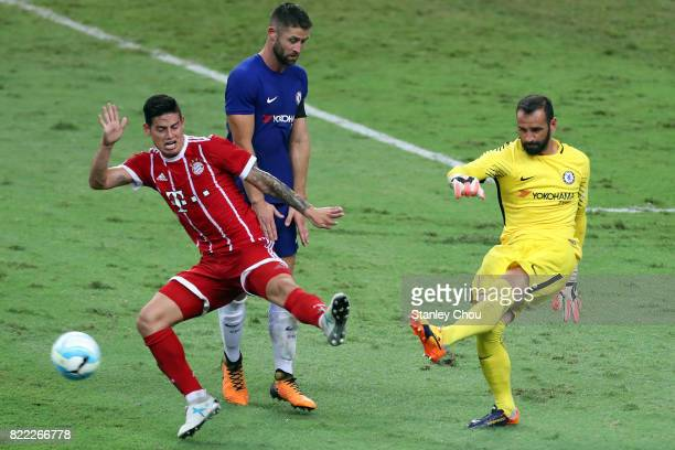 Wilfredo Caballero of Chelsea kicks while challenge James Rodriguez of Bayern Munich during the International Champions Cup match between Chelsea FC...