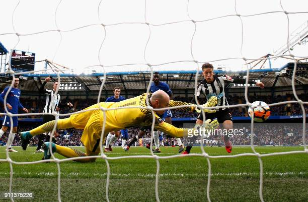 Wilfredo Caballero of Chelsea makes a save from a shot by Dwight Gayle of Newcastle United during The Emirates FA Cup Fourth Round match between...