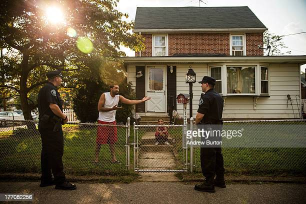Wilfredo Ortiz speaks to foot patrol officers of the Camden County Police Department on August 20, 2013 in the Fairview neighborhood of Camden, New...