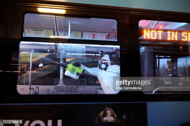 Wilfredo Quispe works through the night to disinfect public buses at the Montgomery County Division of Fleet Management Equipment Maintenance and...