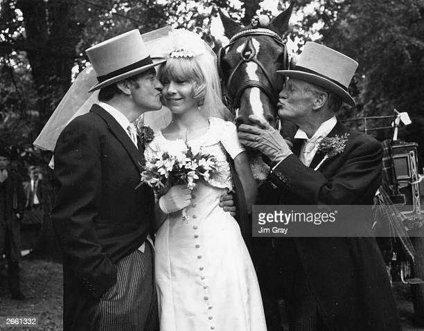Wilfrid Brambell kissing a horse and Harry H Corbett kissing the bride in a scene from the television series 'Steptoe and Son'