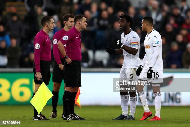 Wilfried Bony and Martin Olsson of Swansea City speak with match officials during the Premier League match between Swansea City and AFC Bournemouth...
