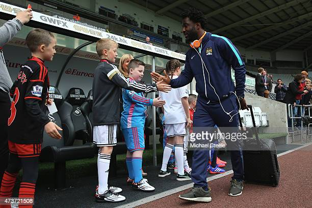 Wilfried Bony of Manchester City greets young Swansea mascots as he arrives at the stadium during the Barclays Premier League match between Swansea...