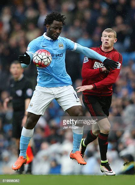 Wilfried Bony of Manchester City is challenged by James McClean of West Bromwich Albion during the Barclays Premier League match between Manchester...